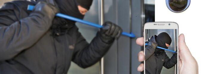 Hilfreicher Einbruchsschutz: Ein Einbrecher wird von einer Videokamera gefilmt und das Geschehen wird auf ein Smartphone übertragen.